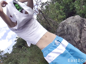 Skinny teen twink is taking pictures at the nature