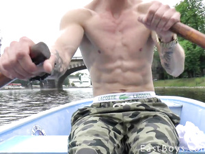 Young twink with camera is filming gay dude rowing oars