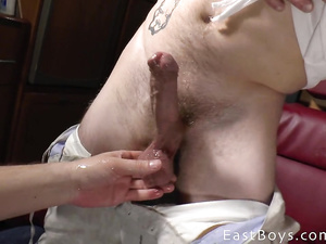 Freaky hunk is jerking twink's dick until he cums
