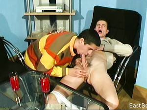 Teen gay is pleasuring hot blowjob on armchair