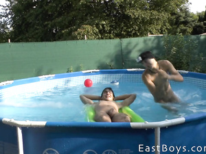 Teen twinks got in the pool and having fun nude