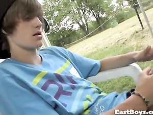 Womanlike twink teen guy is hotly wanking outdoors