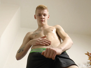 Blonde twink hotly poses to the web camera