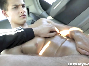 Muscular boy gets massage and handjob in the car