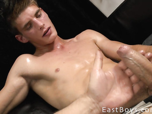 Twink with perfectly sexy shapes is pleasuring hot handjob