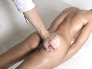 Yummy assed twink enjoys handjob in the shower