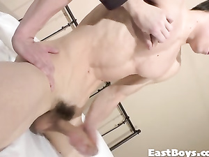 Strong young gay is pleasuring hot masturbation on the bed