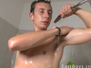 Brunette twink with exciting young body is wanking in shower