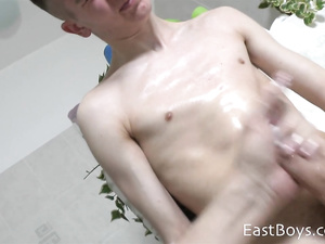 Hunk is pleasuring fondling young gay friend's big dick