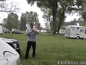 Hunk enjoys fondling young twink in camping trailer