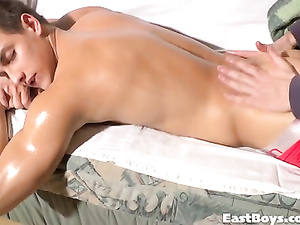 Beautiful brunette twink enjoys exciting massage