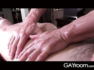 Strong massagist enjoyed sucking young cock