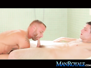 Tattooed hunk is passionately fucking his sissy gay friend in bathtub