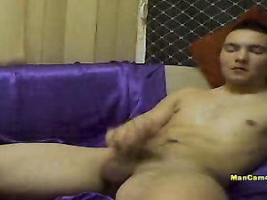 Twink with sexy smooth body is pleasantly masturbating dick