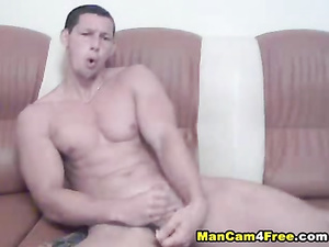 Strong and sexy twink shows off his shapes and fucks with dildo