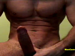 Gay with sexy strong muscles is sitting nude and wanking his dick