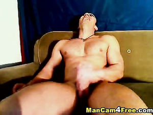 Bald twink is sitting on couch and jerking off on hot gay porn
